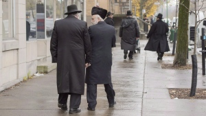Hasidic Jewish men walk along Bernard Street in Outremont, in Montreal on Wednesday, November 16, 2016.  (THE CANADIAN PRESS/Ryan Remiorz)
