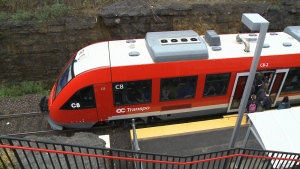 Passengers are seen boarding the O-Train at Carling Station on the The Trillium Line.