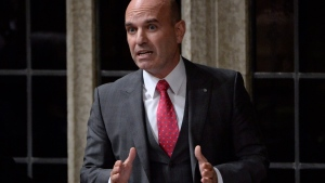 """NDP MP Nathan Cullen rises during question period in the House of Commons in Ottawa, Wednesday, Oct.25, 2017. Cullen is the party's ethics critic. He characterizes the move as """"an olive branch."""" (Adrian Wyld / THE CANADIAN PRESS)"""
