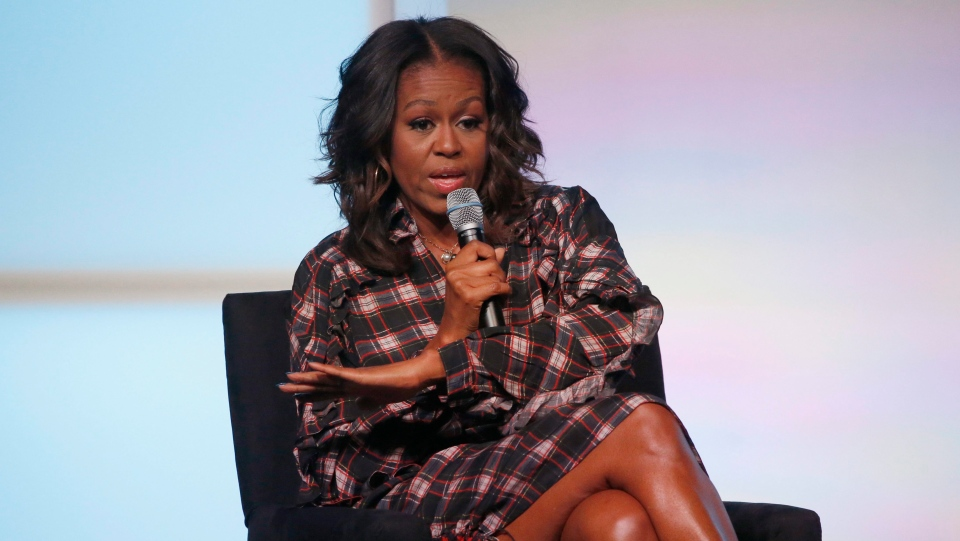 Former first lady Michelle Obama addresses the crowd during a conversation with poet Elizabeth Alexander at the second day of the Obama Foundation Summit Nov. 1, 2017, in Chicago. (Charles Rex Arbogast/AP)