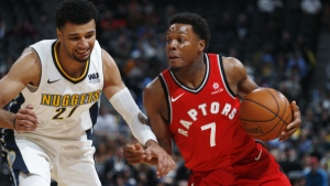 Toronto Raptors guard Kyle Lowry, right, drives past Denver Nuggets guard Jamal Murray in the first half of an NBA basketball game in Denver on Wednesday, Nov. 1, 2017. (AP / David Zalubowski)