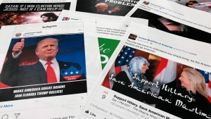Some of the Facebook and Instagram ads linked to a Russian effort to disrupt the American political process and stir up tensions around divisive social issues, released by members of the U.S. House Intelligence committee, are photographed in Washington, on Wednesday, Nov. 1, 2017. (AP Photo/Jon Elswick)