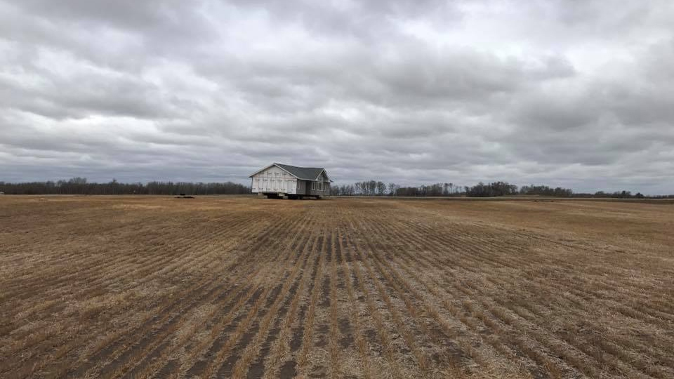 It turns out the house was being transported from Winnipeg to the owner in Lumsden, Sask., but there was a problem with permits.