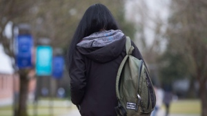 A student carrying a backpack walks on campus at Trinity Western University in Langley, B.C., on Wednesday, February 22, 2017. THE CANADIAN PRESS/Darryl Dyck