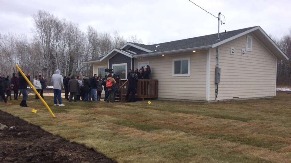 Community members gather outside a newly built home in Lake St. Martin First Nation on Thursday, Nov. 2, 2017. (Source: Twitter, Josh Crabb)