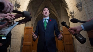 Canadian Prime Minister Justin Trudeau speaks with the media as he makes his way to caucus on Parliament Hill in Ottawa on November 1, 2017. (Adrian Wyld / THE CANADIAN PRESS)