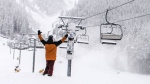 A snowboarder cheers the snow at Mt. Norquay ahead of the hill's opening on Friday, Nov. 3, 2017 (image courtesy: Luke Sudermann)