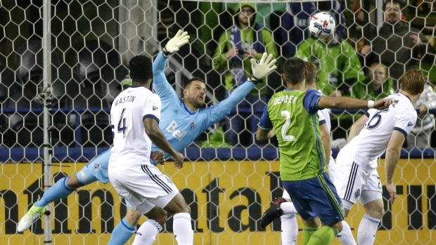 Seattle Sounders forward Clint Dempsey watches as Vancouver Whitecaps goalkeeper Stefan Marinovic, second from left, can't reach his goal during the second half of the second leg of an MLS soccer Western Conference semifinal in Seattle on Thursday, Nov. 2, 2017. (AP / Ted S. Warren)