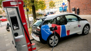In this Wednesday, Oct. 18, 2017 photo a car is connected to a charging station for electric vehicles in Hamburg, Germany. (Daniel Bockwoldt/dpa via AP, File)