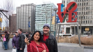Faye Takata, from Hawaii, and Ben Mitchell, of London celebrate their engagement while visiting Dilworth Park in Philadelphia. (Ed Hille/The Philadelphia Inquirer via AP)