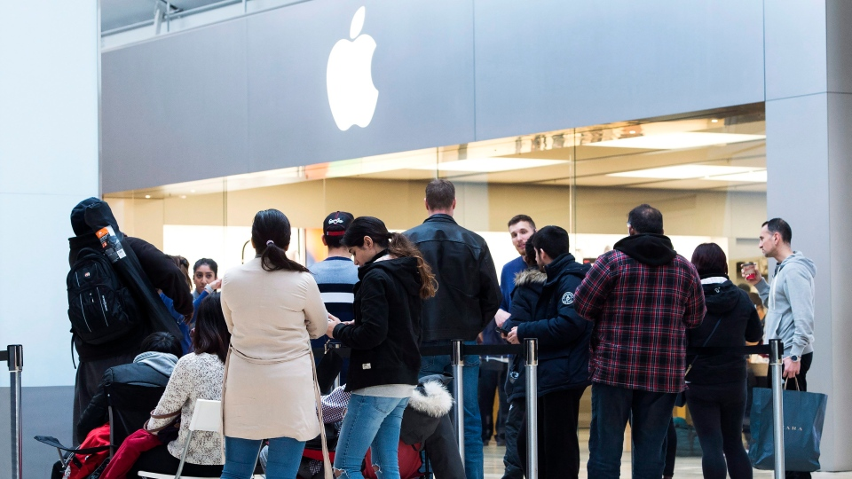 People line up for the new Apple iPhone X at the Square One Shopping Centre in Mississauga, Ont., on Friday, November 3, 2017. (THE CANADIAN PRESS/Nathan Denette)