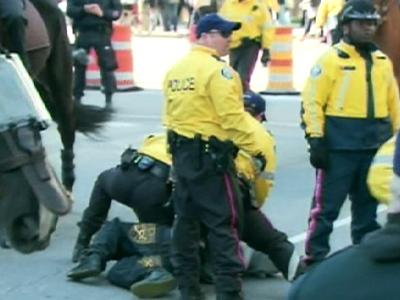 Police make an arrest at a scuffle with Tamil protesters on Wednesday, April 29, 2009 at University Ave. and Dundas St. W.