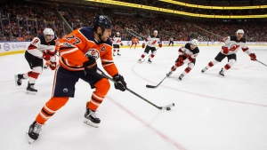 New Jersey Devils give chase as Edmonton Oilers' Milan Lucic (27) controls the puck during second period NHL action in Edmonton on Friday, Nov. 3, 2017. THE CANADIAN PRESS/Jason Franson