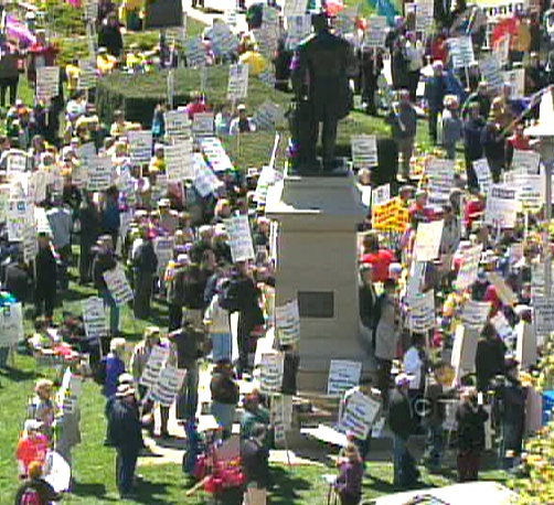 Protesters gather at Queen's Park in Toronto to make their voices heard over health care, Wednesday, April, 29, 2009.