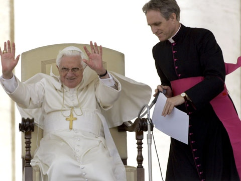 Pope Benedict XVI, left, with his secretary Monsignor Georg Gaenswein, greets the faithful during the weekly general audience in St. Peter's Square at the Vatican, Wednesday April 29, 2009. (AP / Pier Paolo Cito)
