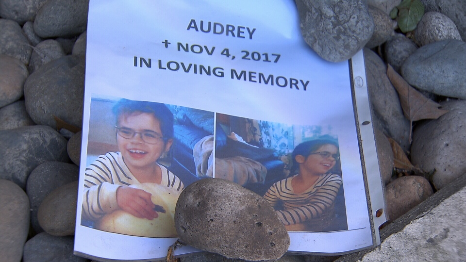 A memorial is growing at the spot where an eight-year-old girl fell to her death from a Burnaby highrise. It identifies her only as Audrey.