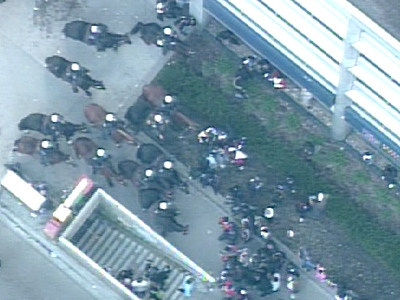Mounted Toronto police officers face down a crowd of Tamil demonstrators near Dundas St. W. and University Ave. on Wednesday, April 29, 2009.