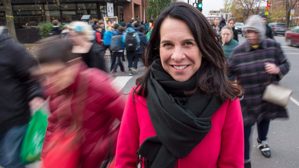 Montreal mayor Valerie Plante stands on a busy street corner Wednesday, November 1, 2017 in Montreal. (THE CANADIAN PRESS/Paul Chiasson)