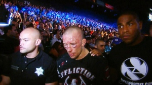 Georges St-Pierre, right, of Canada, celebrates after defeating England's Michael Bisping, left, in a middleweight title mixed martial arts bout at UFC 217 early Sunday, Nov. 5, 2017, in New York. (AP Photo/Frank Franklin II)