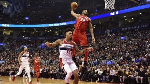 Toronto Raptors forward Norman Powell dunks past Washington Wizards forward Kelly Oubre Jr. during first half NBA basketball action in Toronto on Sunday, Nov. 5, 2017. (Frank Gunn / THE CANADIAN PRESS)