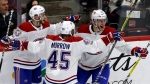 Montreal Canadiens centre Jonathan Drouin, right, celebrates with defenseman Victor Mete, left, and defenseman Joe Morrow after scoring a goal against the Chicago Blackhawks during the third period of an NHL hockey game, Sunday, Nov. 5, 2017, in Chicago. The Canadiens won 2-0. (AP Photo/Nam Y. Huh)