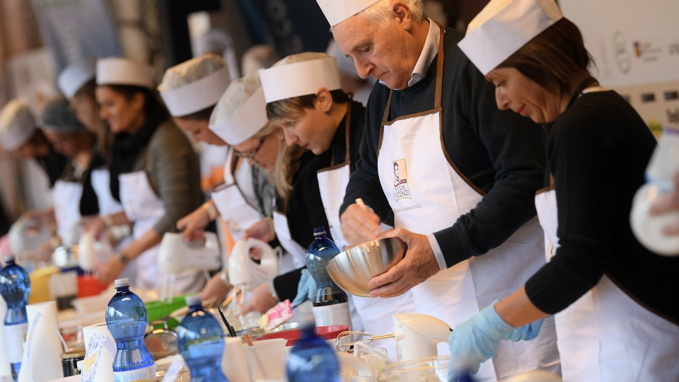 "Hundreds of would-be pudding maestros descended on the city of Treviso armed with whisks and sieves to compete in the two-day challenge to make the best tiramisu, which means ""pick-me-up"" in Italian. (© MARCO BERTORELLO / AFP)"