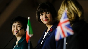Canada's Minister of Health Ginette Petipas Taylor, center, smiles during the final press conference at the G7 Health Ministerial Meeting in Milan, Italy, Monday, Nov. 6, 2017. (Luca Bruno / AP Photo)