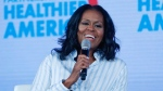 In this Friday, May 12, 2017, file photo, former first lady Michelle Obama smiles while speaking at the Partnership for a Healthier American 2017 Healthier Future Summit in Washington.  (AP Photo/Pablo Martinez Monsivais, File)