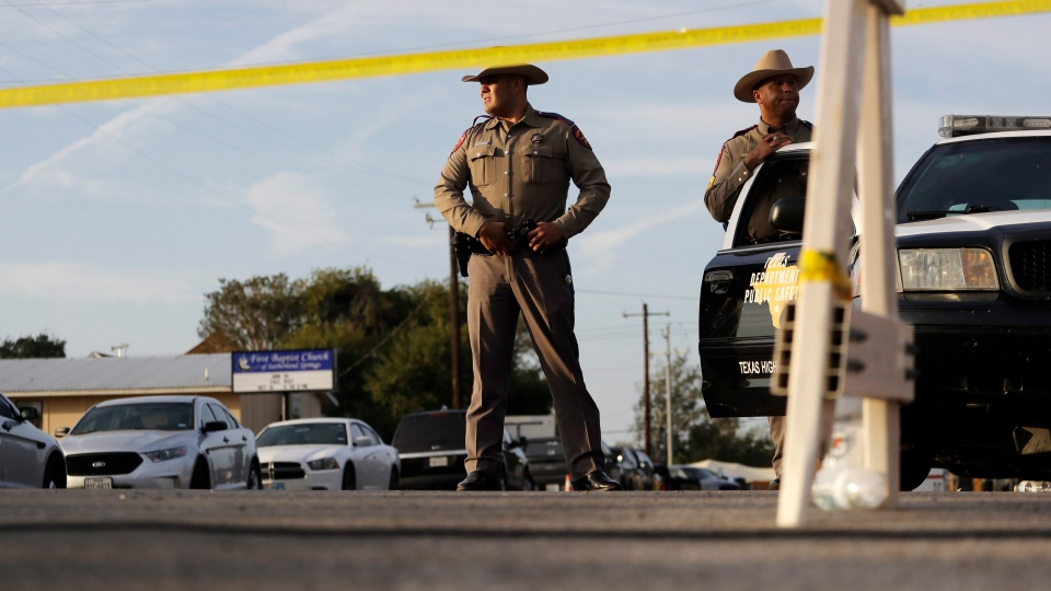 Law enforcement officials work the scene of a shooting at the First Baptist Church of Sutherland Springs, Monday, Nov. 6, 2017, in Sutherland Springs, Texas. A man opened fire inside the church in the small South Texas community on Sunday, killing more than 20 and wounding others. (AP Photo/Eric Gay)