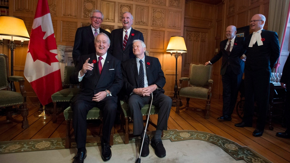 Former Prime Ministers Brian Mulroney, front left, and John Turner, sit with Joe Clark, rear left, and Paul Martin as they mark the 150th anniversary of the first meeting of the first Parliament of Canada, in Ottawa on Monday, Nov. 6, 2017. (Justin Tang / THE CANADIAN PRESS)