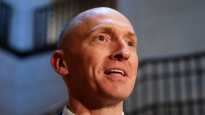 In this Nov. 2, 2017, photo, Carter Page, a foreign policy adviser to Donald Trump's 2016 presidential campaign, speaks with reporters following a day of questions from the House Intelligence Committee, on Capitol Hill in Washington. (AP Photo/J. Scott Applewhite)