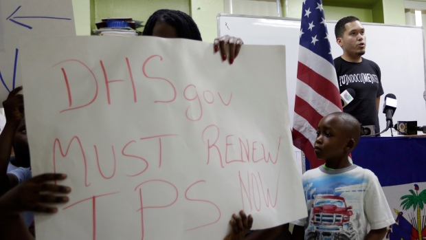 Julio Calderon, 28, upper right, an undocumented immigrant from Honduras, speaks in favor of renewing Temporary Protected Status (TPS) for immigrants from Central America and Haiti now living in the United States, during a news conference Monday, Nov. 6, 2017, in Miami. (AP / Lynne Sladky)