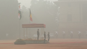 Belgium's King Philippe inspects a military guard of honour, surrounded by smog, at the Indian Presidential palace in New Delhi, India, Tuesday, Nov. 7, 2017. (AP / Manish Swarup)