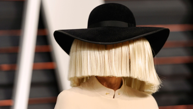 In this Feb. 22, 2015, file photo, Sia arrives at the 2015 Vanity Fair Oscar Party in Beverly Hills, Calif. (Photo by Evan Agostini/Invision/AP, File)