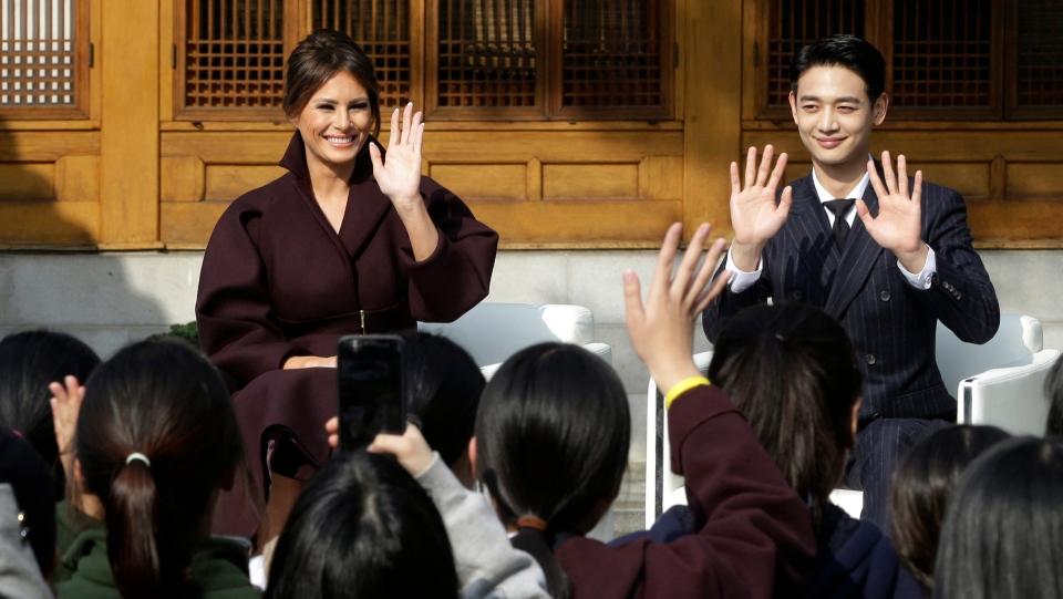 U.S. first lady Melania Trump and Choi Min-ho, a member of South Korean boy band Shinee, at the U.S. Ambassador's Residence in Seoul, South Korea, Nov. 7, 2017. (AP Photo/Ahn Young-joon. Pool)