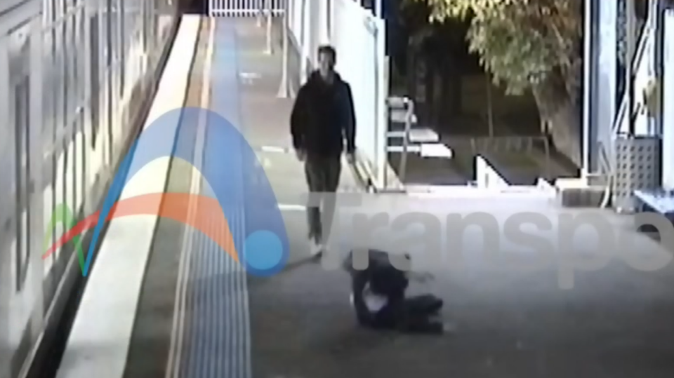 An unidentified man who jumped across train tracks in Sydney, Australia can be seen rolling onto the platform, narrowly avoiding a fatal collision.