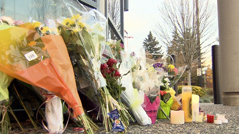 Flowers and candles were left in a memorial outside the Abbotsford Police Department on Tuesday, Nov. 7, 2017.