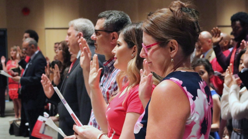 People take the citizenship oath at Pier 21 immigration centre in Halifax on July 1, 2017. (THE CANADIAN PRESS/Adina Bresge)