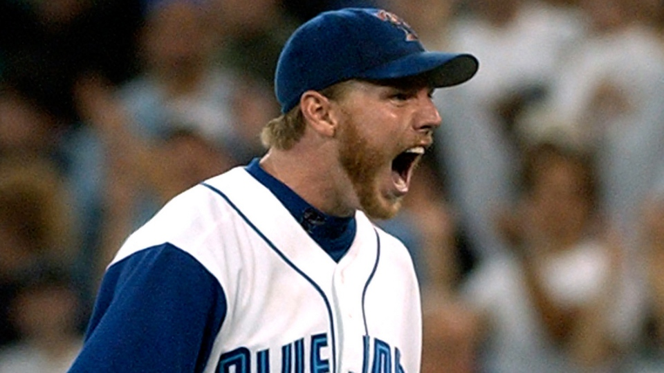 Toronto Blue Jays pitcher Roy Halladay reacts following a game in Toronto on September 26, 2003. Former Toronto Blue Jays star pitcher Roy Halladay died Tuesday after his plane crashed in the Gulf of Mexico. He was 40. THE CANADIAN PRESS/Fred Thornhill