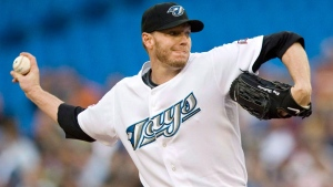 Toronto Blue Jays pitcher Roy Halladay works against the Tampa Bay Rays during first inning AL baseball action in Toronto on August 24, 2009. Former Toronto Blue Jays star pitcher Roy Halladay has died after his plane crashed in the Gulf of Mexico. He was 40. THE CANADIAN PRESS/Darren Calabrese