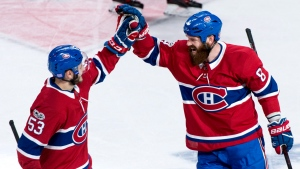 Montreal Canadiens' Jordie Benn, right, celebrates his goal with teammate Victor Mete as they face the Vegas Golden Knights. THE CANADIAN PRESS/Paul Chiasson