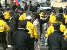 Toronto police move protesters off University Avenue in downtown Toronto, Thursday morning, April 30, 2009.