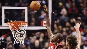 Toronto Raptors forward Serge Ibaka drives to the basket past Chicago Bulls centre Robin Lopez during second half NBA basketball action in Toronto on Tuesday, Nov. 7, 2017. (Frank Gunn / THE CANADIAN PRESS)