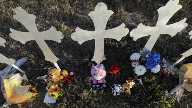 Flowers and stuffed animals rest at the base of crosses at a makeshift memorial for the First Baptist Church victims in Sutherland Springs, Texas on Tuesday, Nov. 7, 2017. (AP / David J. Phillip)