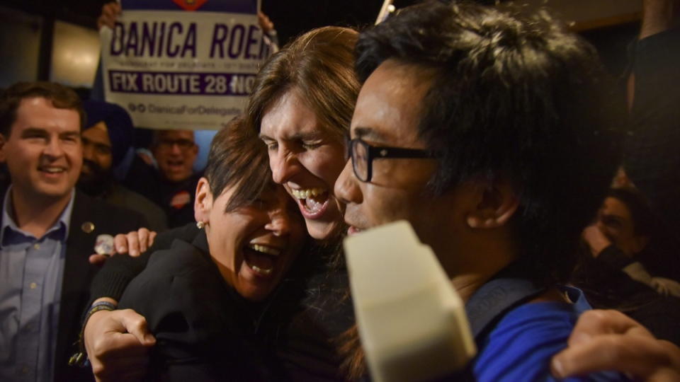 Danica Roem, centre, a Democrat who ran for Virginia's House of Delegates against GOP incumbent Robert Marshall, is greeted by supporters as she prepares to give her victory speech on Nov. 7, 2017. (Jahi Chikwendiu / The Washington Post via AP)
