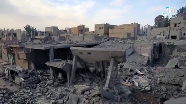 This image, made from militant video posted online on April. 18, 2017, purports to shows destroyed houses following a U.S.-led coalition strike in the eastern Syrian town of Boukamal, on the Iraqi border. (Aamaq News Agency via AP)