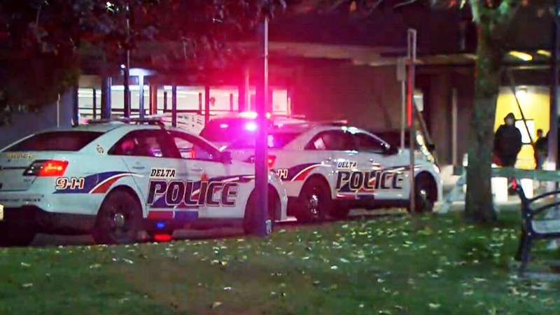 Police vehicles are seen outside a Delta, B.C. community centre on Tuesday, Nov. 8, 2017.