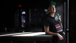 Volunteer chef Mikiki, who has been living with HIV for 10 years poses for a portrait at the pop up restaurant June's HIV+ Eatery in Toronto on Tuesday, Nov. 7, 2017. THE CANADIAN PRESS/Chris Donovan