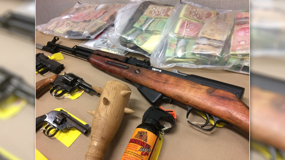 Knives, brass knuckles, bear spray, and a club were also on display among the seized weapons on Wednesday, Nov. 8, 2017. (Ottawa Police)