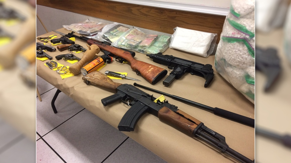 Seized in the raids were: an AK-47 and an AR-15 with high capacity magazines; an SKS semi-automatic rifle with a bayonet; an Uzi submachine gun; six handguns; and ammunition for each.